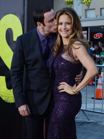 Travolta and Preston smooch at premiere