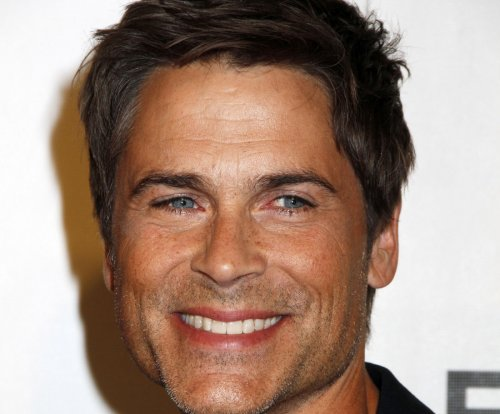 Watch shirtless Rob Lowe lip sync 'The Hills are Alive'