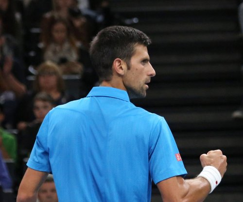 Novak Djokovic outlasts Milos Raonic at ATP finals