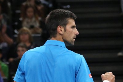 Novak Djokovic outlasts Milos Raonic at ATP finals