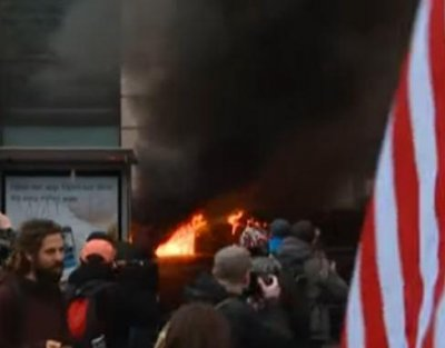 Dozens in D.C. arrested for rioting against Trump; limo set on fire