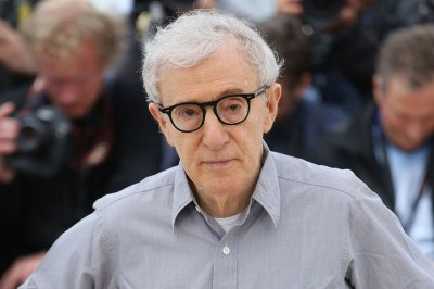 Topless protestors interrupt Woody Allen jazz concert in Germany