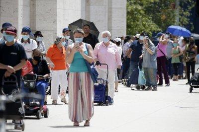 New U.S. COVID-19 cases again top 70K; experts urge more mask use