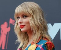 Taylor Swift has comedic debate with Stephen Colbert over song 'Hey Stephen'