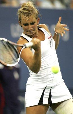Petkovic, Bacsinszky win 1st-round matches