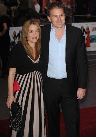 Pregnant Anderson falls at film premiere