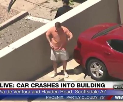 Arizona man's dad-dance for news chopper goes viral