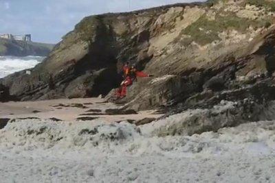 Watch: Helicopter team rescues dog trapped on ledge in deep sea foam
