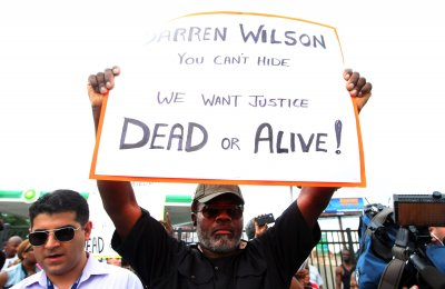 Ferguson police chief marches with protesters calling for his resignation