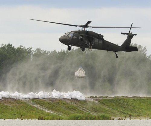 Search for bodies from Blackhawk crash suspended; 9 recovered