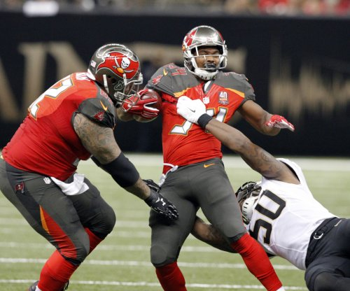 Tampa Bay Buccaneers place RB Charles Sims on IR, promote Russell Hansbrough