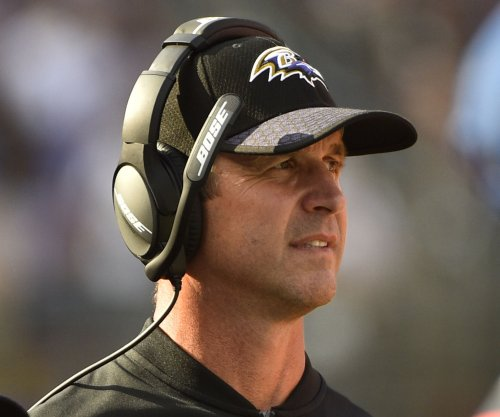 Ravens' Harbaugh: 'I believe in standing for the flag'
