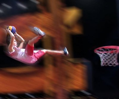 Italian launches from trampoline, slam dunks from 26 feet away