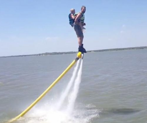 Jet ski racer and son soar over water with 'flying attachment'