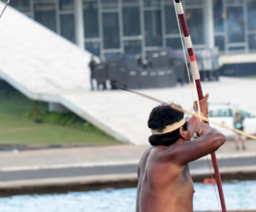 Brazilian indigenous groups shoot arrows at police during clashes