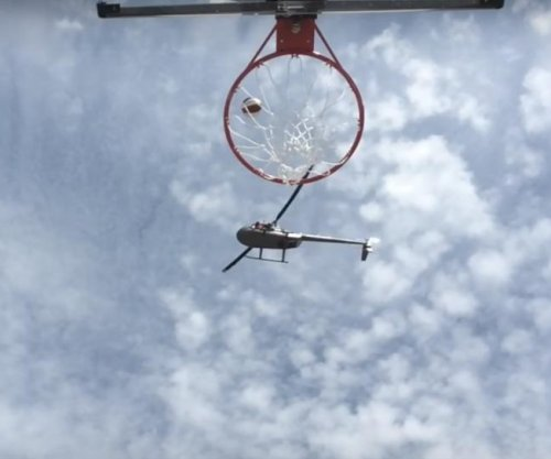 Harlem Globetrotters swish ridiculous helicopter shot