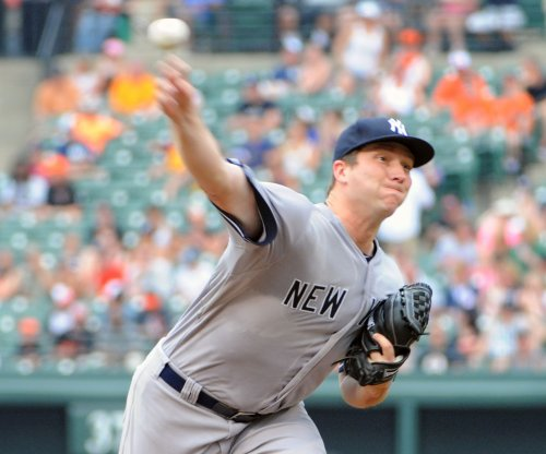 New York Yankees place pitcher Adam Warren on disabled list