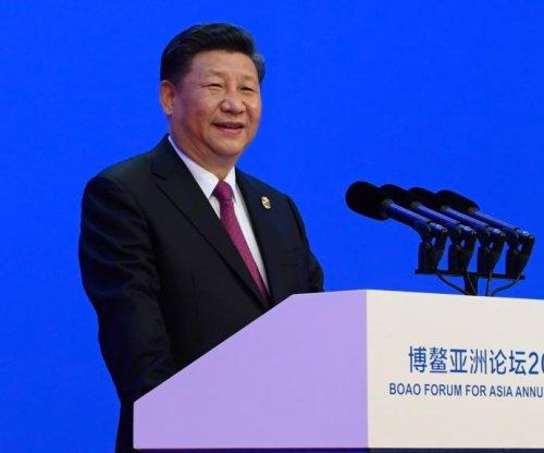 Xi Jinping upholds free trade, pledges economic liberalization