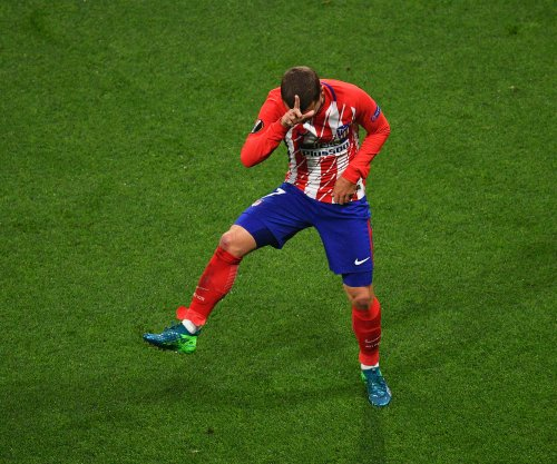 Griezmann scores twice, leads Atletico Madrid to Europa League title