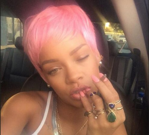 Rihanna ditches long locks for pink pixie cut wig