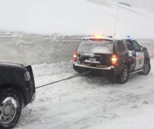 Police SUV helping snow-stranded vehicles gets stuck in snow