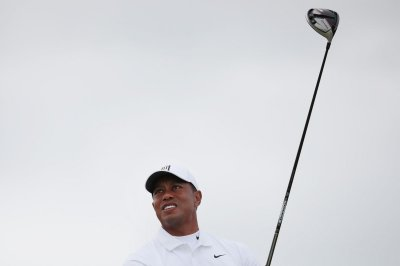 Tiger Woods limited at Liberty National with back stiffness