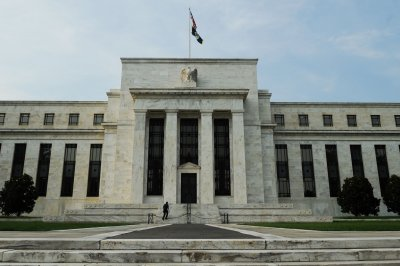 Fed leaves key rates unchanged, doesn't expect hike until 2022