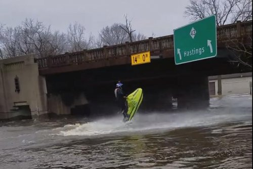 Flooded Michigan road plays host to kayaks, jet skis