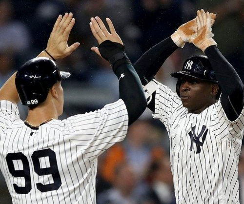 Chris Carter's glove, bat help New York Yankees defeat Kansas City Royals