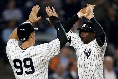 Chris Carter's glove, bat help New York Yankees defeat Kansas City Royals