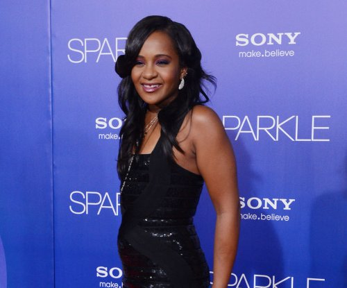 Bobbi Kristina's breathing tube removed; tracheotomy performed