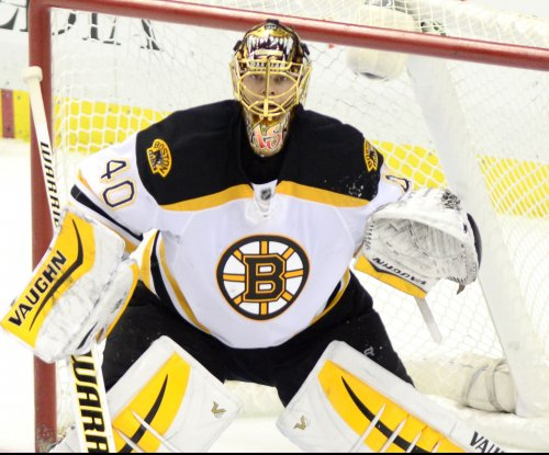 Boston Bruins' Tuukka Rask leaves after taking shot to head