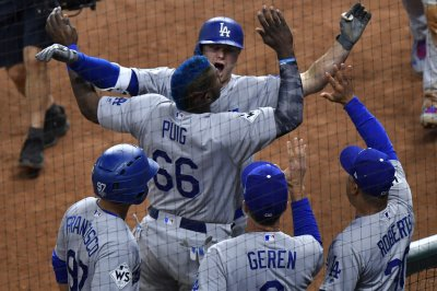 World Series: Los Angeles Dodgers use big ninth to stun Houston Astros