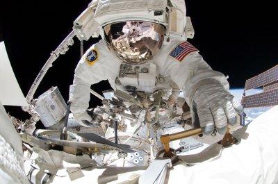 Astronauts fix up after last spacewalk