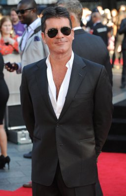 Simon Cowell denies claims that he is gay