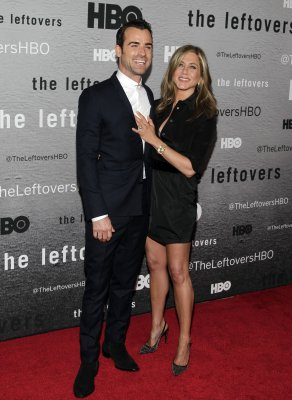Jennifer Aniston surprised by Justin Theroux during photo shoot