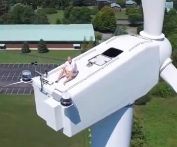 Drone user finds man sunbathing atop wind turbine