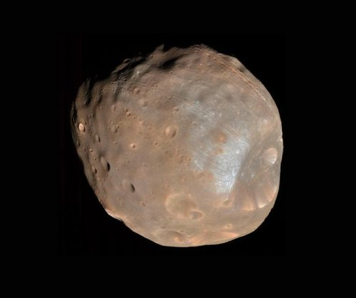 Martian moon likely forged by ancient impact, study finds
