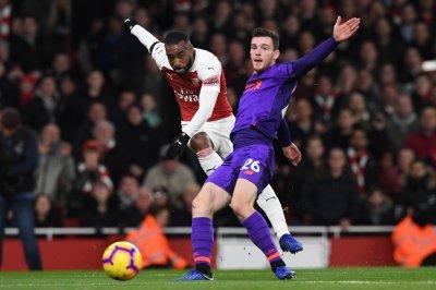 Arsenal's Alexander Lacazette curls in equalizer vs. Liverpool