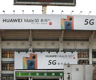 Britain allows Huawei to play limited role in 5G rollout