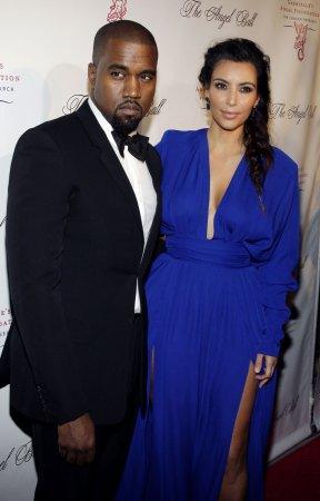 Kim Kardashian and Kanye West check on wedding details in Paris