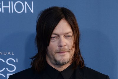 Norman Reedus and Diane Kruger spotted kissing