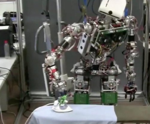 Spanish university develops humanoid ironing robot