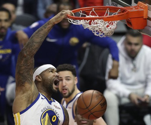 DeMarcus Cousins announces arrival with slam in Warriors debut