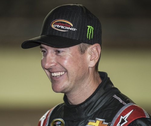 Kurt Busch wins rain-shortened race at Michigan