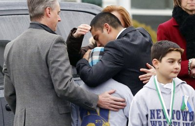 First school shooting victims buried