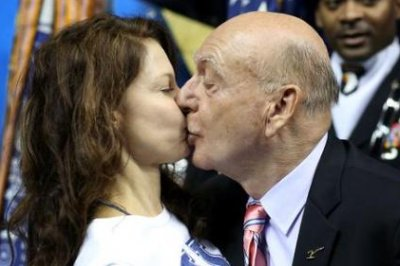 Ashley Judd gets pecked by Dick Vitale during Wildcats game