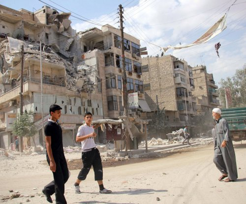 Rebel mortar and rocket attacks kill 21 civilians in Aleppo, Syria