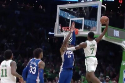 Celtics' Jaylen Brown dunks all over 76ers' Joel Embiid