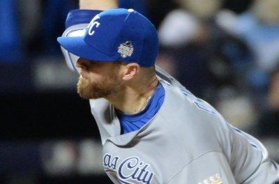Kansas City Royals pick up options on Wade Davis, Alcides Escobar